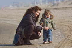 Mother and cute boy on the beach Royalty Free Stock Image