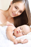 mother and cute child in bed Royalty Free Stock Photography