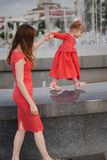 Mother with cute daughter at fountain Royalty Free Stock Photo