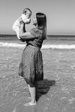 Mother and cute little baby girl on the beach Royalty Free Stock Photography