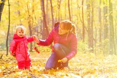 Mother and cute little daughter in autumn fall Royalty Free Stock Images