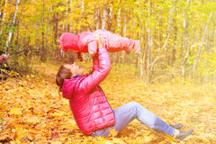 Mother and cute little daughter in autumn fall Stock Image