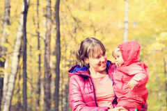 Mother and cute little daughter in autumn fall Royalty Free Stock Image