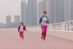 Mother and cute little girl on the promenade Stock Image