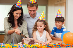 Mother cutting birthday cake Royalty Free Stock Image
