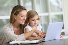 Mother and daighter working on the laptop Stock Image