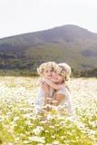 Mother and daugher in field of daisy flowers Royalty Free Stock Photo
