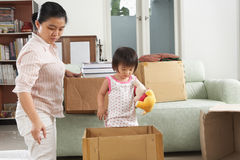 Mother and daugher packing Stock Photography