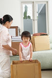 Mother and daugher packing Royalty Free Stock Image