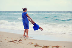 Mother and daugher playing on beach Royalty Free Stock Image