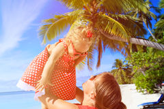 Mother and daugher playing on summer beach Stock Photo