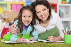 Mother and daughte drawing pictures Stock Photos