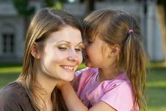 Mother and daughter. Mother listening her daughter in the park Stock Photography