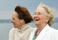 Mother and daughter. A senior mother and middle aged daughter enjoying being together on the shore of Lake Constance, Germany Stock Photo