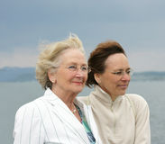 Mother and daughter. A senior mother and middle aged daughter enjoying being together on the shore of Lake Constance, Germany Stock Photography