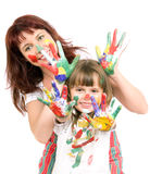 Mother  with  daughter. Mother together with a daughter is shown with palms soiled with a paint of different colors, smile.  Profile Adobe RGB (1998 Stock Photography