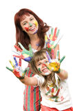 Mother  with  daughter. Mother together with a daughter is shown with palms soiled with a paint of different colors, smile.  Profile Adobe RGB (1998 Stock Images