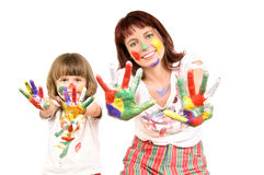 Mother  with  daughter. Mother together with a daughter is shown with palms soiled with a paint of different colors, smile.  Profile Adobe RGB (1998 Royalty Free Stock Image