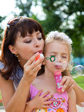 Mother and the daughter. In a park Royalty Free Stock Photo