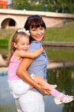 Mother and the daughter. In a park Stock Photos