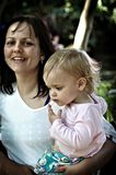 Mother and Daughter. Lomofied image of a smiling young mother and her daughter royalty free stock photos