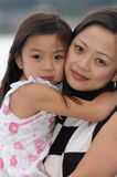Mother and daughter. Modern young woman with her daughter Royalty Free Stock Photo
