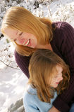 Mother and daughter. Laughing in the snow Royalty Free Stock Photography