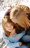 Mother and daughter. Laughing in the snow Stock Photo