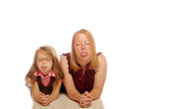 Mother and daughter. Posing on an isolated background Royalty Free Stock Photos