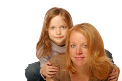 Mother and daughter. Posing on an isolated background Stock Image