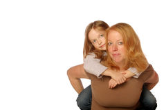Mother and daughter. Posing on an isolated background Stock Photography