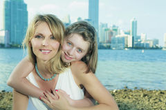 Mother and Daughter. Lifestyle image on the shoreline of Miami's Biscayne Bay with skyline in the background stock photo
