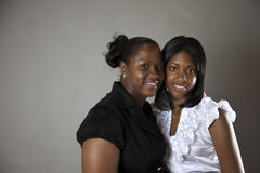 Mother and daughter. A smiling African American mother and daughter face to face Stock Image