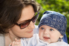 Mother and daughter. Looking each other. Close up and blurred background Royalty Free Stock Image