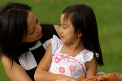Mother and Daughter. Sharing a smile Royalty Free Stock Photography