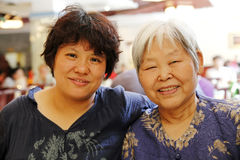 Mother and daughter. Happy Chinese mother and daughter in a restaurant Stock Images