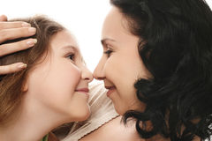 Mother and daughter. Embraces of mother and daughter. Two happy smiling female, adult and young Stock Image