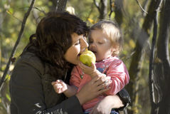 Mother and the daughter. Play the nature together Royalty Free Stock Photography