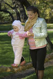 Mother and the daughter. Mother plays with the daughter in park in the autumn Royalty Free Stock Photos
