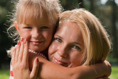 Mother and daughter. Young mother and young daughter embracing each other Stock Image