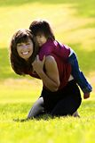Mother & Daughter. Mother and Daughter palying in the park Stock Images