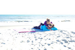 Mother and daughter. Playing at the beach Royalty Free Stock Photography
