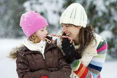 Mother and Daughter. A Mom playing with her child in the snow Royalty Free Stock Photos