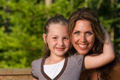 Mother and Daughter. A cute young girl with her Mother Stock Image