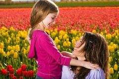 Mother and Daughter. A Mother and her Daughter in a field of colorful tulips Stock Images