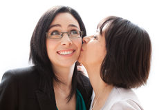Mother and daughter. Affectionate mother giving her daughter a kiss Stock Image