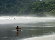 Mother and daughter. On Playa Espadilla, Manuel Antonio, Costa Rica stock photography
