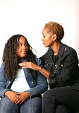 Mother and Daughter. Mother wearing jean jacket instructs young daughter Stock Photography
