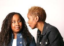 Mother and Daughter. Mother wearing jean jacket instructs young daughter Stock Images