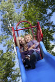 Mother and daughter. On a slide in a park Royalty Free Stock Photos